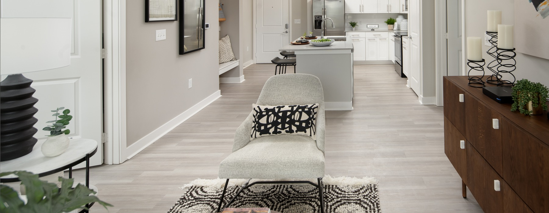 Spacious and well lit living room with an open floorplan style that leads right into the kitchen.